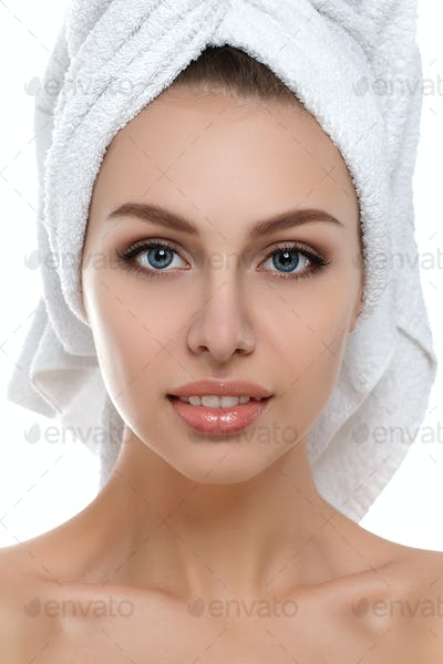 Portrait of young woman with towel on her head