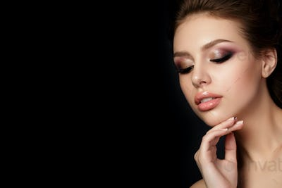 Portrait of young beautiful woman with evening make up