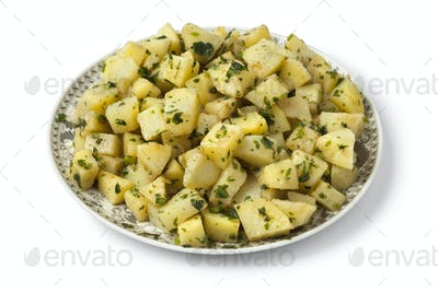 Moroccan dish with potato salad and herbs