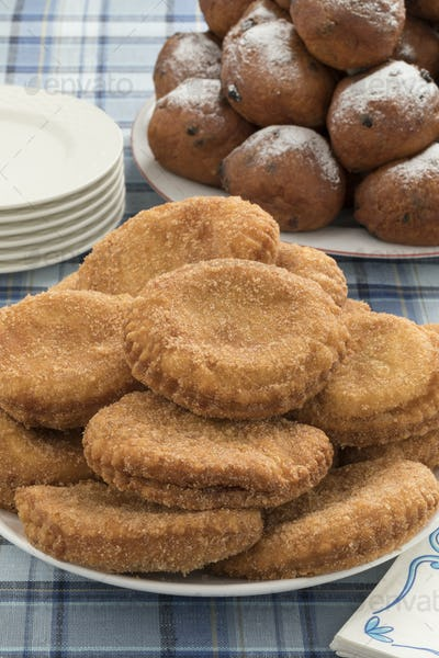 Dish with appelflappen, a traditional Dutch pastry for New Year'
