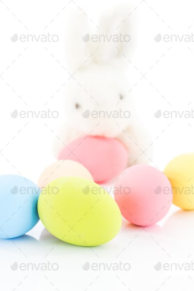 Easter eggs and rabbit on white