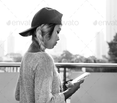 Young woman using a smartphone in the cityscape