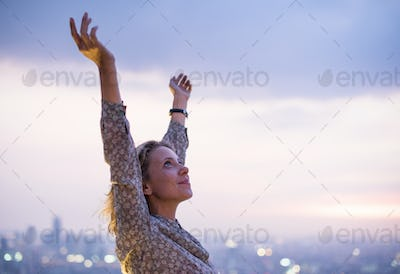 Happy woman at a rooftop