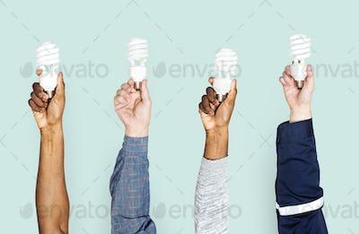 Variation hands holding led lights