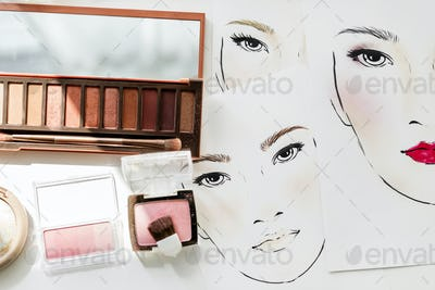 Closeup of blushers and eyeshadow on face charts