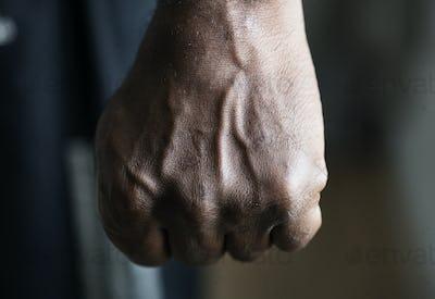 Closeup of a black hand in fist