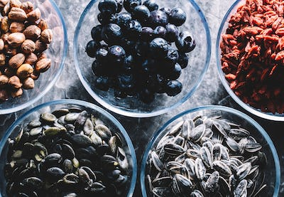 Five glass bowls of different superfoods.