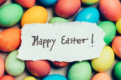 """Happy Easter"" written on a piece of white paper"