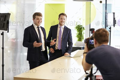 Cameraman and two businessmen making a corporate video