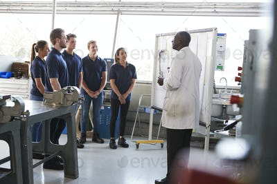Engineering apprentices standing at a training presentation