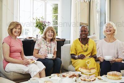 Portrait Of Senior Female Friends Enjoying Afternoon Tea At Home