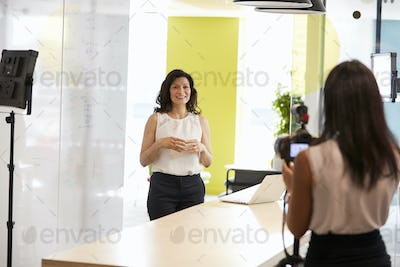 Two women filming a corporate demonstration video
