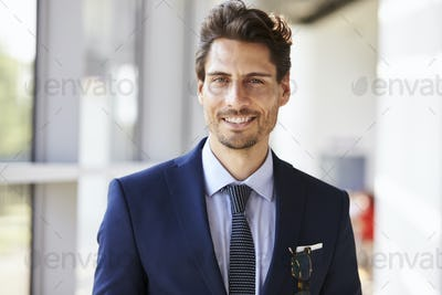 Portrait of smiling professional young man in suit