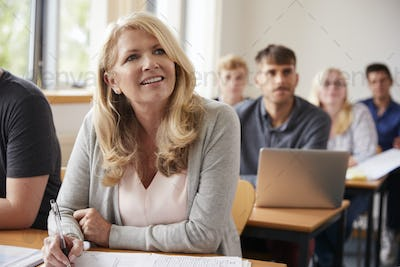 Mature Woman In College Attending Adult Education Class