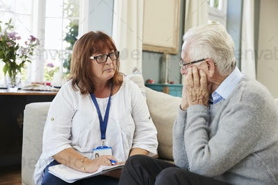Support Worker Visits Senior Man Suffering With Depression