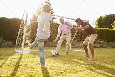 Three male generations of a family playing football