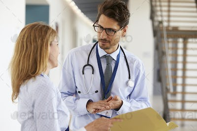 Young male and female doctors consulting each other