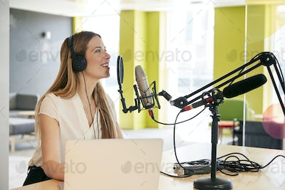 Young woman broadcasting in a studio, close up