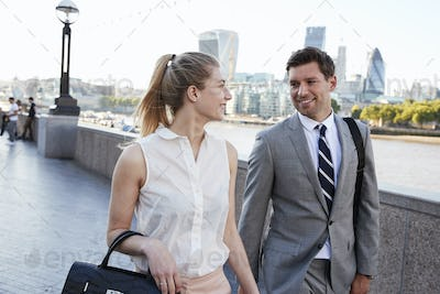 Businesspeople Walking To Work By River Thames In London