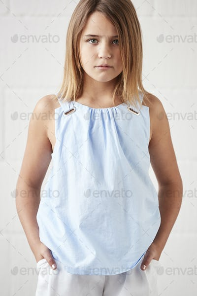Portrait Of Stylish Young Girl Posing In Studio Against White