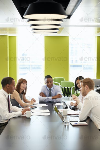 Business colleagues at an informal meeting, vertical