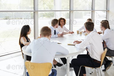 Young businesswoman chairing a business team meeting