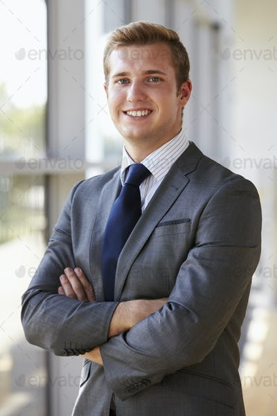 Portrait of a young smiling professional man, arms crossed