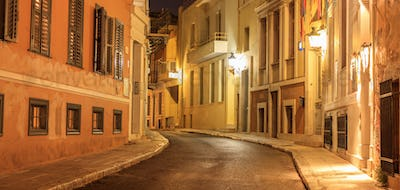 Plaka by night, Athens, traditional buildings at the sides of a street. Architecture in Greece.