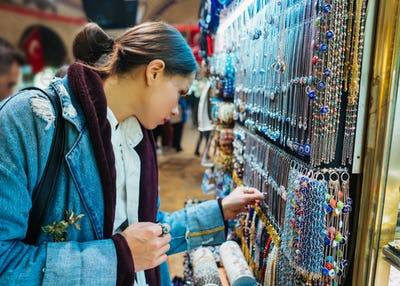 Young girl tourist walking in the souvenir market