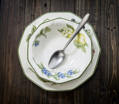 porcelain floral pattern plates with antique cutlery