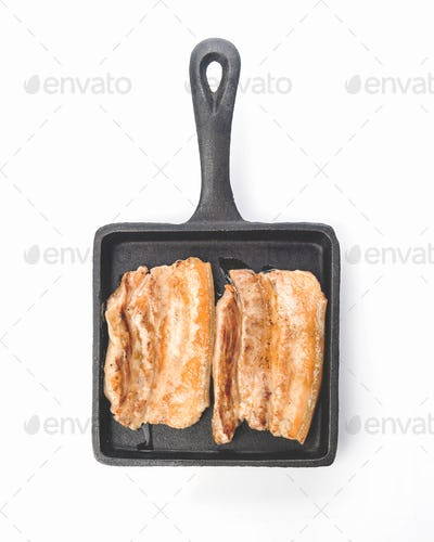 pieces of roasted pork belly on earthenware tray
