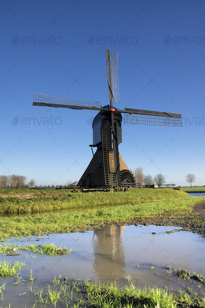 Noordeveldse windmill with a clear blue sky