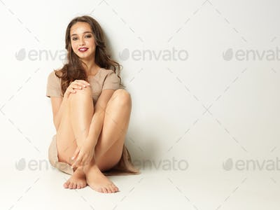 studio fashion portrait young woman sitting smiling