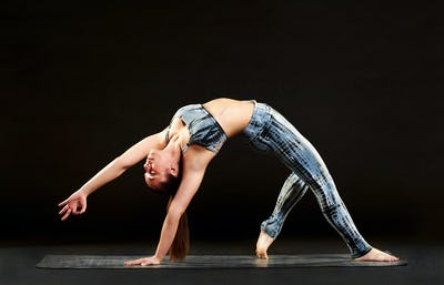 Fit supple young woman doing a wild thing pose