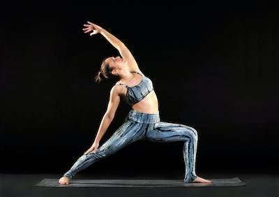 Young woman demonstrating a reverse warrior pose