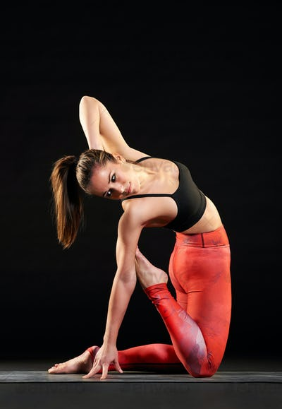 Muscular fit woman doing a camel pose variation