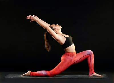 Fit woman demonstrating a low lunge pose