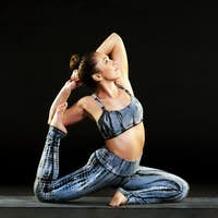 Young woman doing a mermaid or pigeon pose