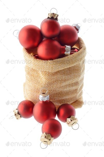 Red Christmas tree balls in a bag of Santa Claus