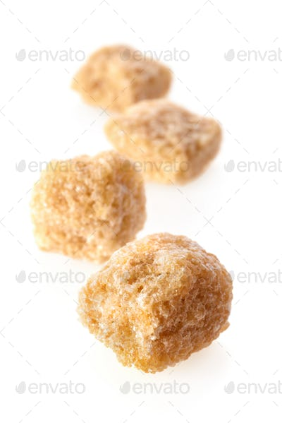 Pieces of cane sugar
