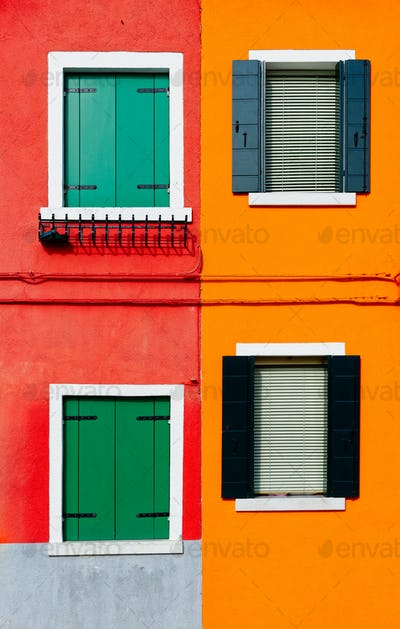 Burano details, windows on red and orange walls