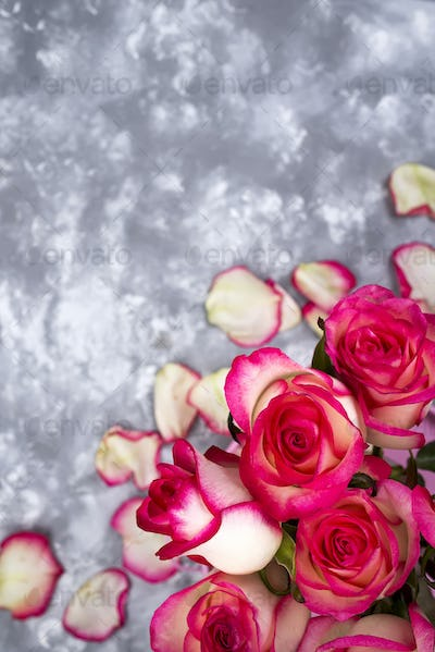 Frame of Red white rose flower bouquet on stone table.