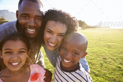Portrait of a smiling black family outdoors, close up
