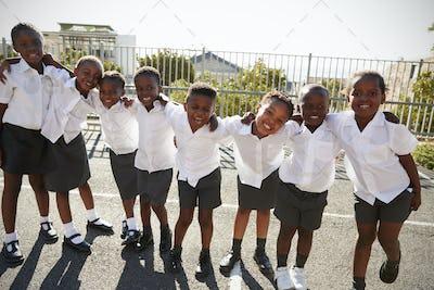 Elementary school kids in Africa posing in school playground