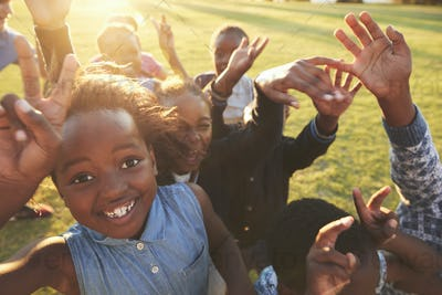 Elementary school kids outdoors, high angle, lens flare
