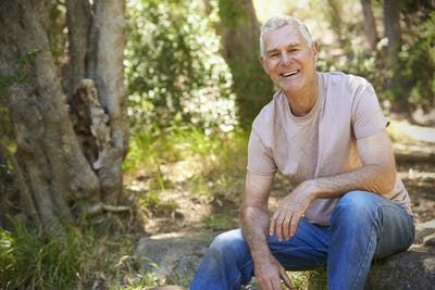 Outdoor Portrait Of Mature Man In Woodland