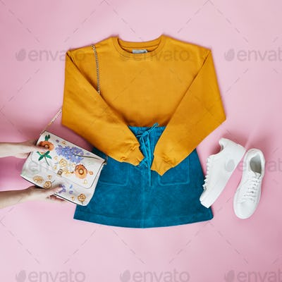 Hands Arranging Flat Lay Female Parisian Style Clothing