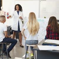 Science teacher giving presentation in school science class