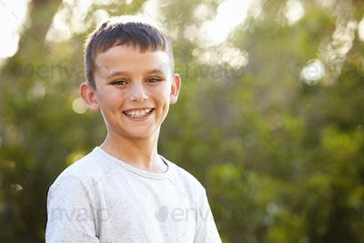 Portrait of a smiling white boy looking to camera