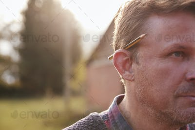 Mature Workman With Pencil Behind His Ear